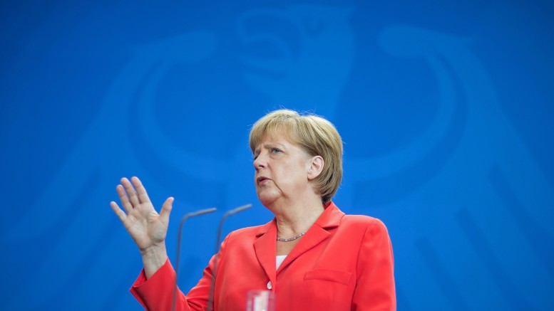 German Chancellor Angela Merkel addresses a news conference after talks with Myanmar's President Thein Sein at the Chancellery in Berlin September 3, 2014. REUTERS/Hannibal (GERMANY - Tags: POLITICS)